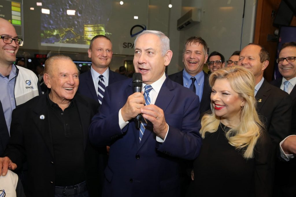 Prime Minister Benjamin Netanyahu with his wife Sara, and SpaceIL President Morris Kahn, left, at the Beresheet control room in Yehud, April 11, 2019