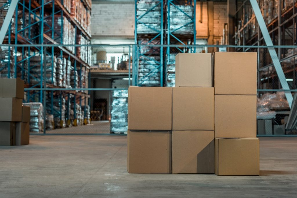 An illustrative photo of packages in a warehouse. Deposit Photos