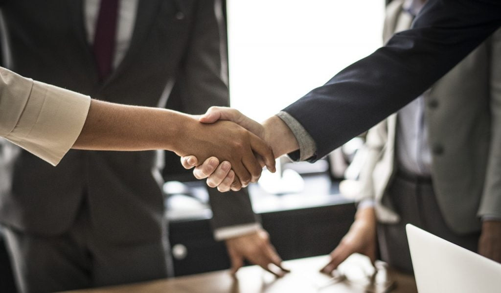 An illustrative photo of a handshake. Photo via Pixabay