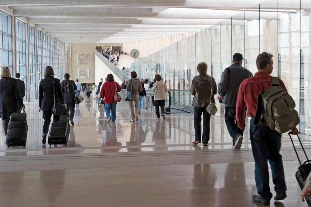 Passengers at Ben Gurion Airport. Deposit Photos