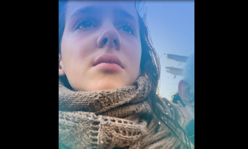 A screenshot from Eva Stories showing the British actress who portrays Eva crying.