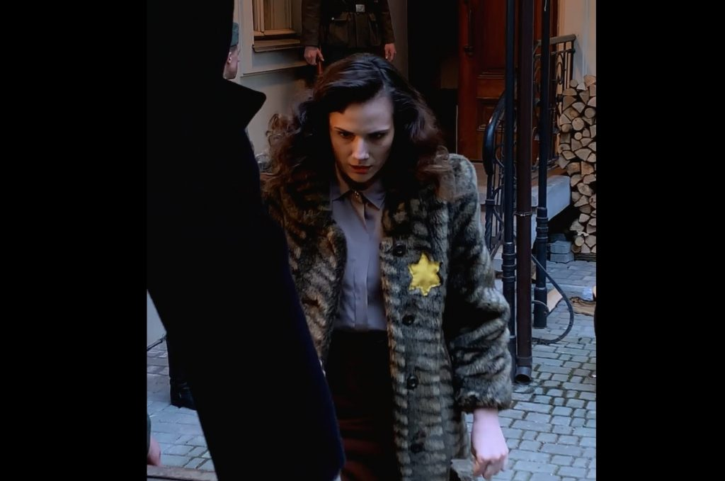 A screenshot from Eva Stories showing a young woman forced into a truck as part of the deportation of Jews in Hungary.
