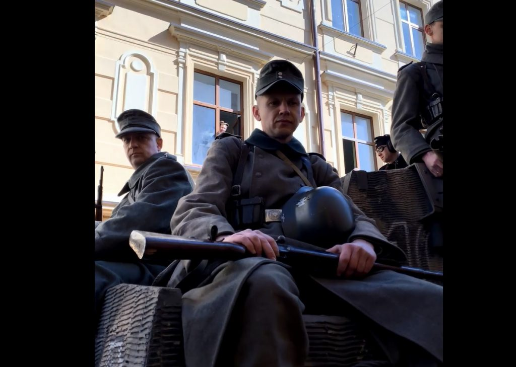 A screenshot from Eva Stories showing actors playing invading Nazi forces.