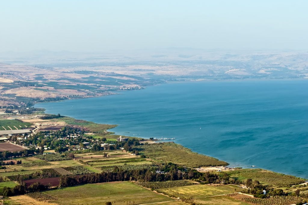 View of the Sea of Galilee in the summer . Deposit Photos