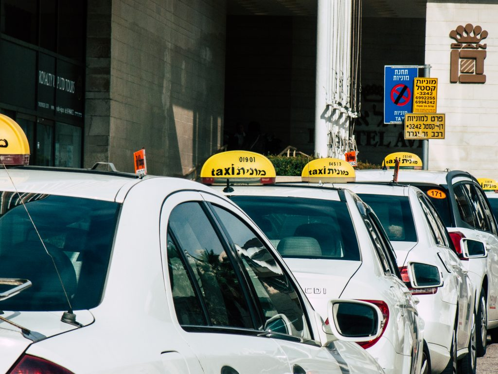 A row of traditional Israeli taxis. Deposit Photos