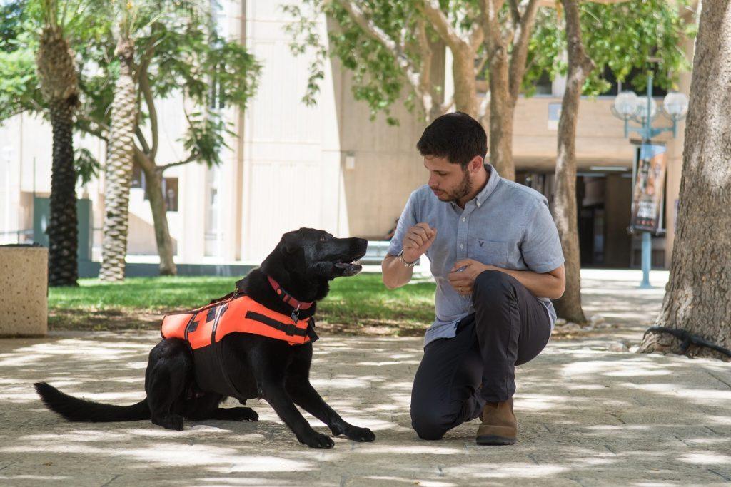BGU PhD student Yoav Golan, with his dog Tai, test haptic tech for dog training. Courtesy