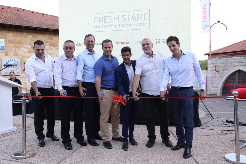 "Members of the ""Fresh Start"" consortium launch the incubator in Kiryat Shmona. Courtesy"