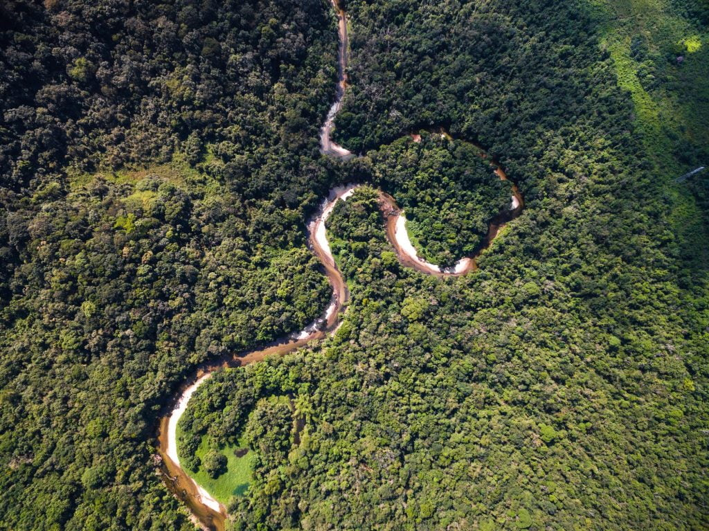A top view of the river in the Amazon rainforest in Brazil. Deposit Photos