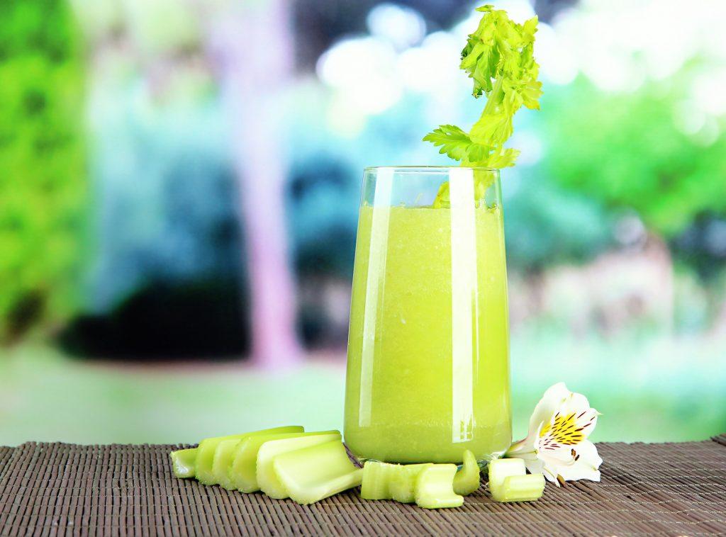 Glass of celery juice. Deposit Photos