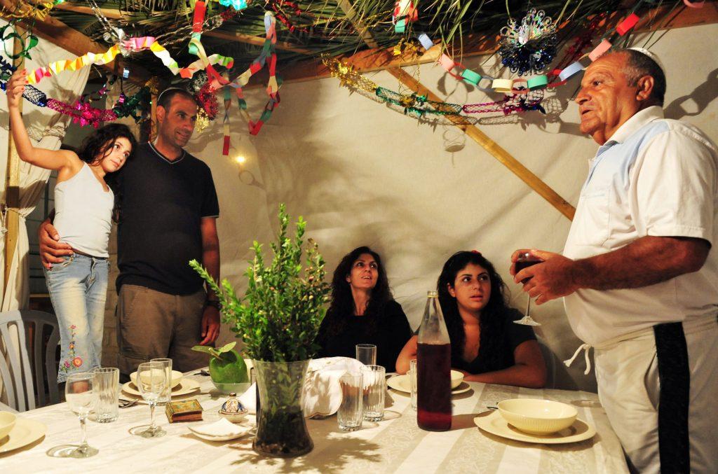 An Israeli family in a sukkah