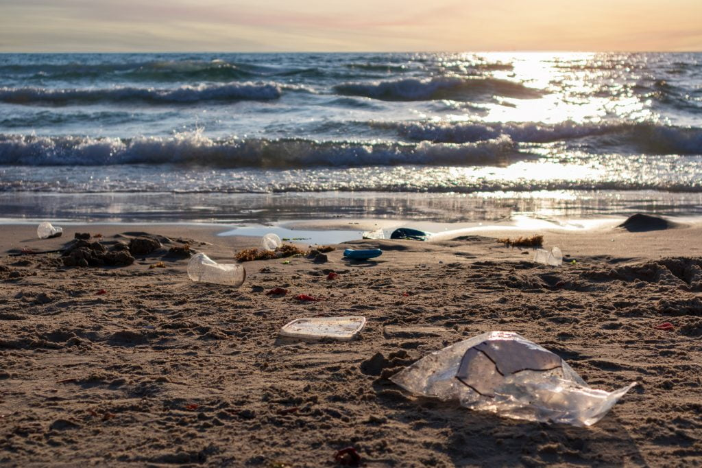Plastic trash on the beach in Israel.  Deposit Photos