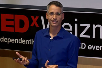Professor Ron Milo at a Tedx Talk. Screenshot