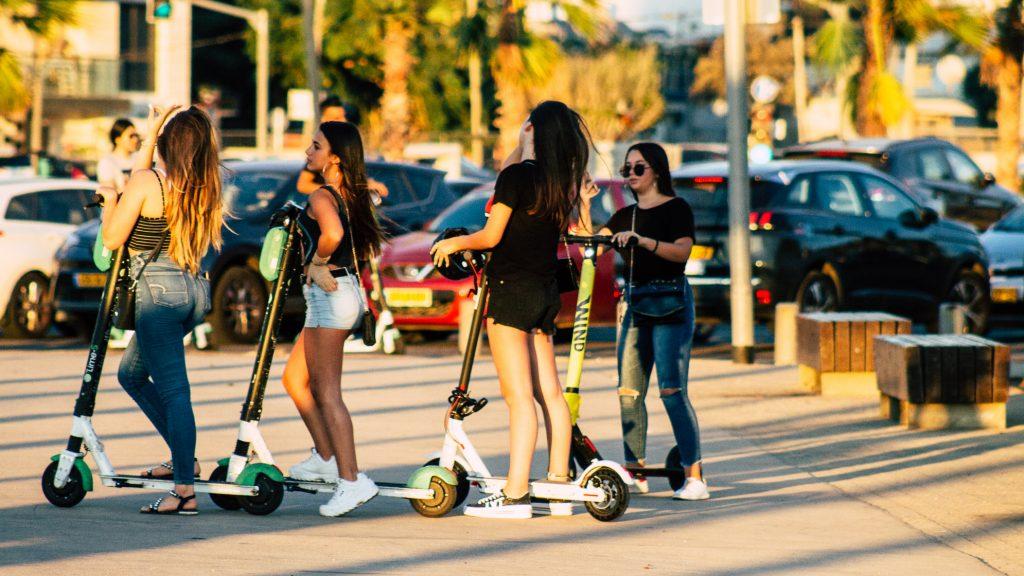 Scooter riders in Tel Aviv. October 2019. Deposit Photos