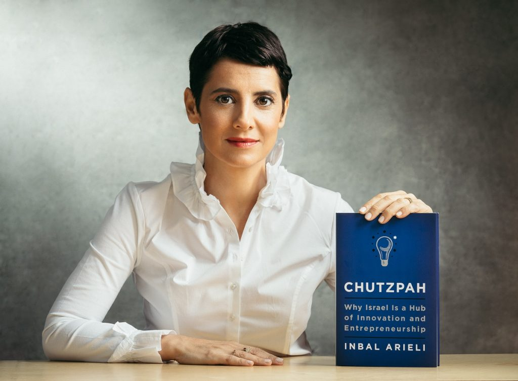 Inbal Arieli with her book 'Chutzpah: Why Israel Is a Hub of Innovation and Entrepreneurship.' Photo by Micha