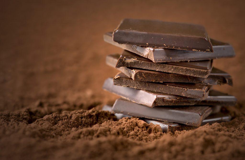 Stacked chocolate bars. Illustrative. Deposit Photos