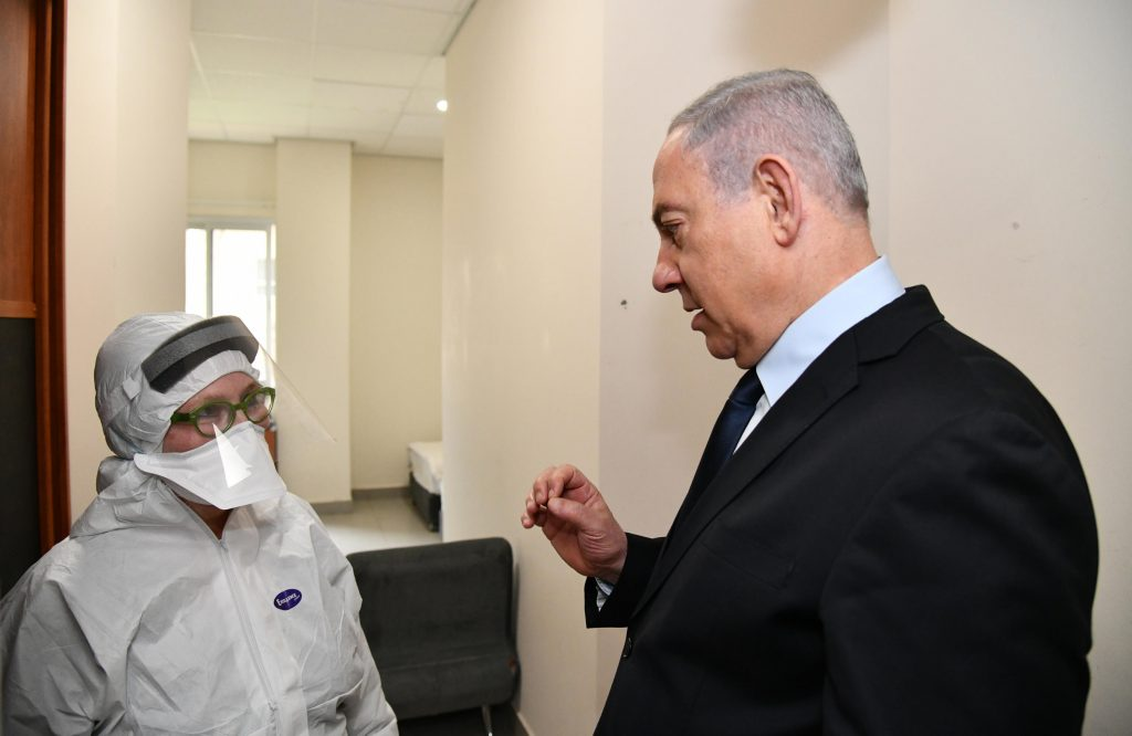Prime Minister Benjamin Netanyahu at Sheba Medical Center as the hospital prepares to care for 11 Israelis back from a coronavirus-stricken cruise ship. Photo: Haim Zach / GPO