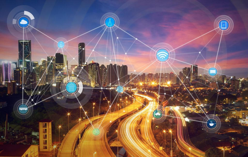 Cybersecurity tech: An illustration of connected devices across a smart city. Deposit Photos