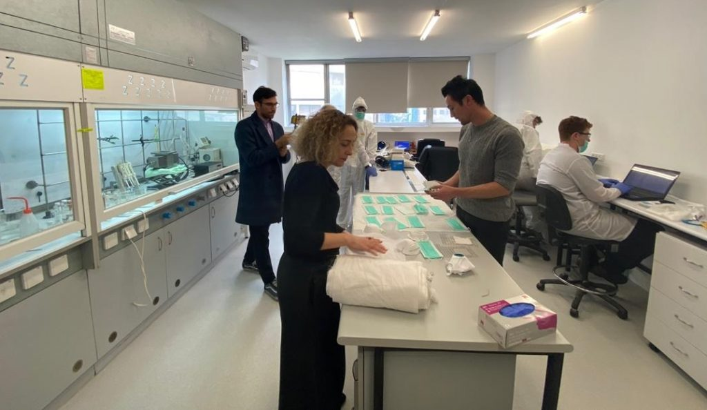 The Sonovia team preparing resistant fabric to be shipped to China. Courtesy