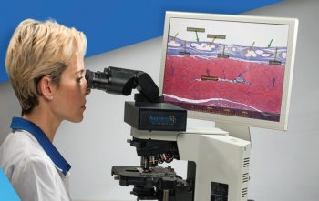 Medical professional using Israeli startup Augmentiqs' AR for microscopes. Courtesy