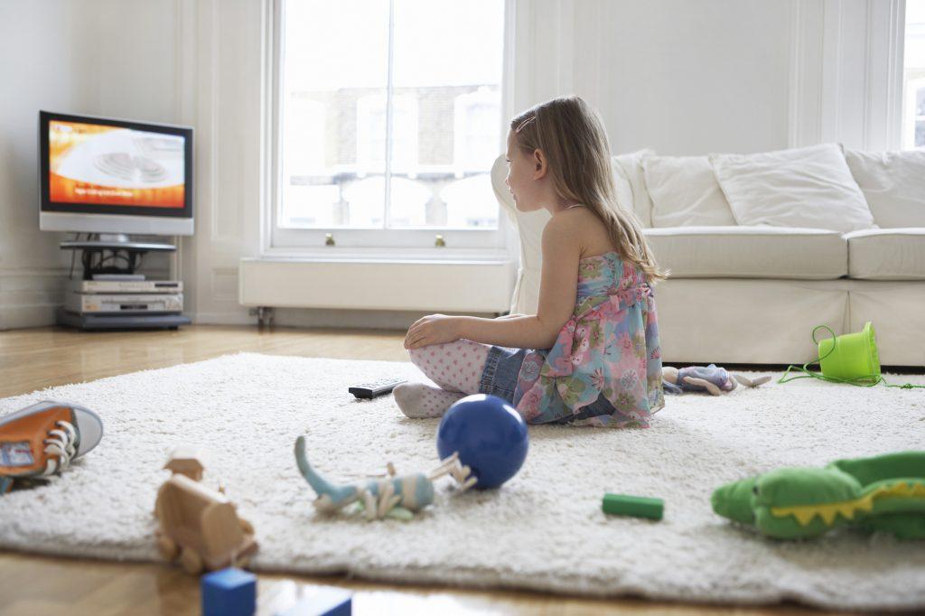 A child watching TV. Illustrative. Deposit Photos