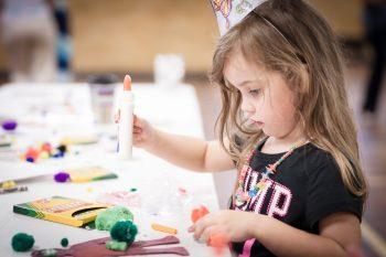 An illustrtative photo of a child making crafts. Deposit Photos