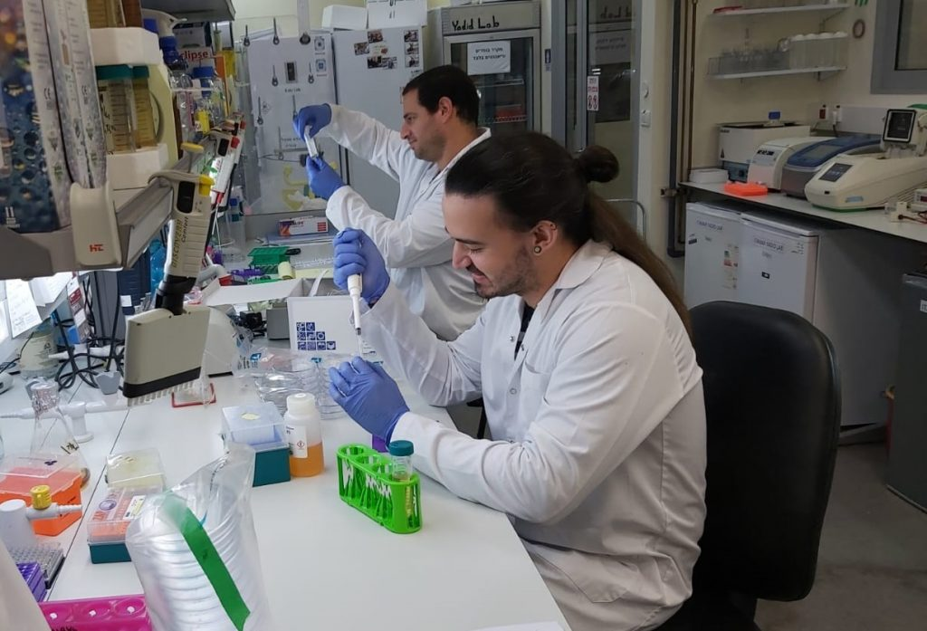 Scientists at the Migal Research Institute lab which is working on developing a coronavirus vaccine. March 2020. Courtesy