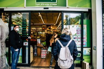 People in Tel Aviv wait in line at a grocery store. April 2020. Deposit Photos