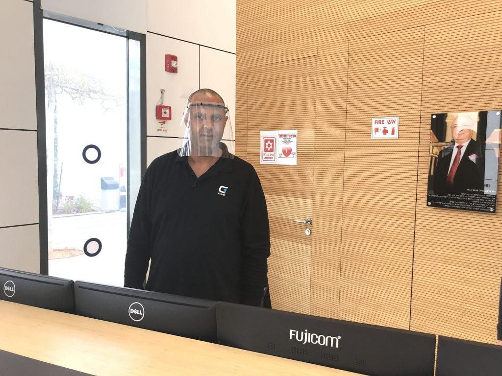 IDC security guard wears face shield