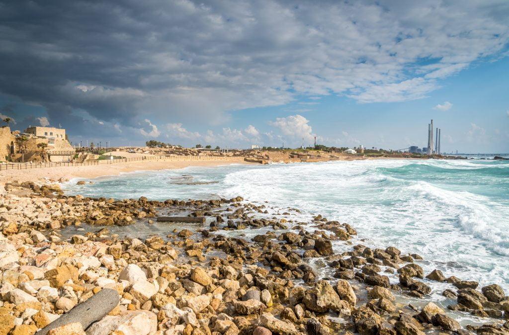 Stormy skies in Caesaria where the coastline is being eroded. Deposit photos