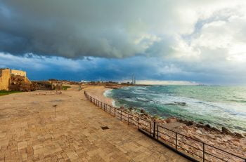 The ruins of the Caesarea Maritima along the coast. Deposit Photos
