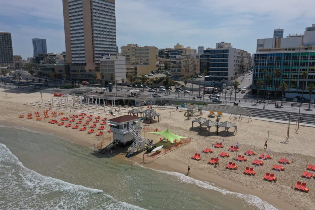A Tel Aviv beach puts seating at least two meters apart in line with social distancing rules. Photo: Ilan Spira